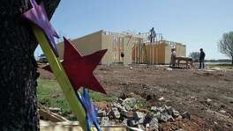 Construction work on a home which was destroyed by the fertilizer plant explosion in April of 2013 Tuesday, March 25, 2014, in West.