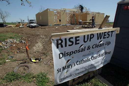 Construction work on a home which was destroyed by the fertilizer plant explosion in April of 2013 Tuesday, March 25, 2014, in West. Photo: James Nielsen, Houston Chronicle / © 2014  Houston Chronicle