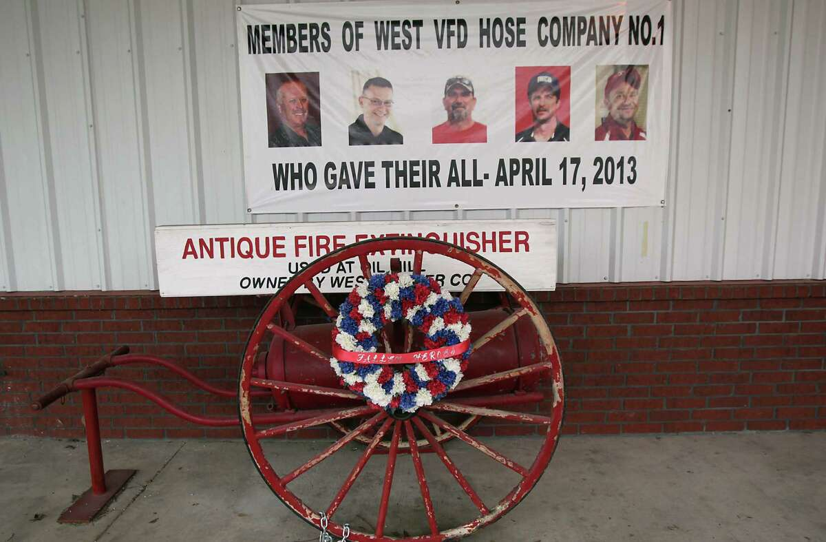 This memorial outside the West Volunteer Fire Department is for the responders who were killed last year at the West Fertilizer Plant. As the anniversary approaches, residents are coming to terms with the fact that the town is a different place now.