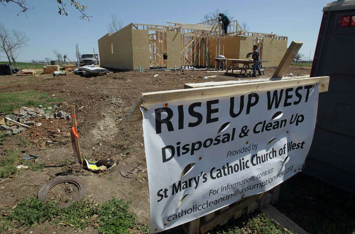 A continuing sight in West is that of construction work, like this being done on a home that will replace a house destroyed when the fertilizer plant exploded.