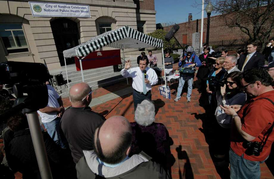 Sen. Ted Cruz works the crowd Saturday in Nashua, N.H., one of several rallies in the key primary state. He also spoke at the Koch brothers-financed Freedom Summit. Photo: Geoff Forester