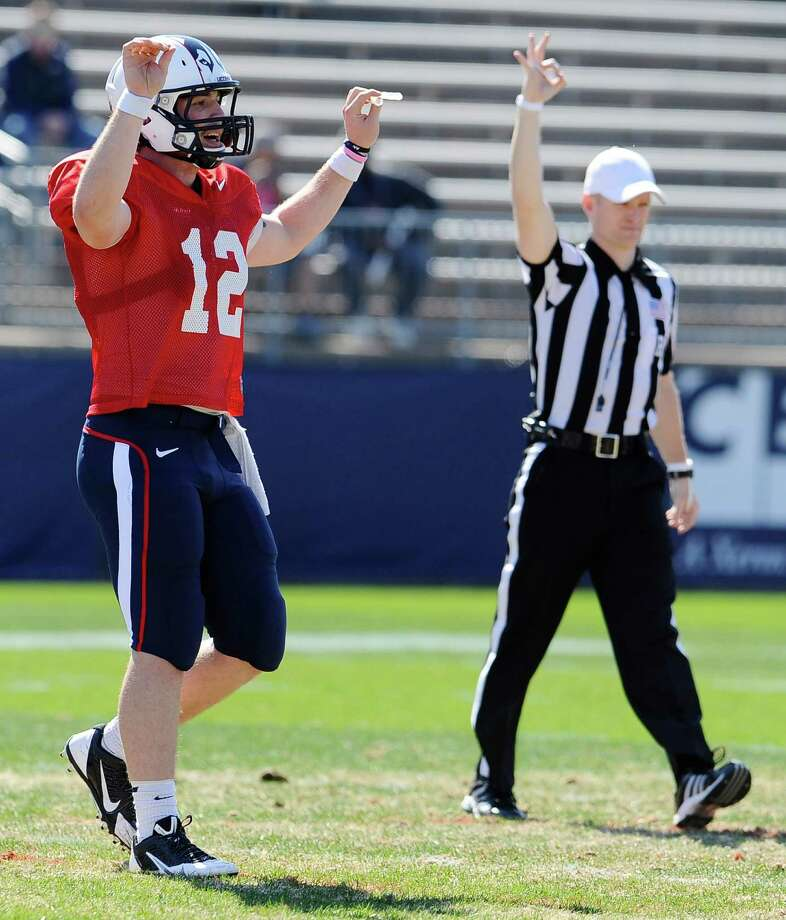 Connecticut quarterback Casey Cochran, left, gestures to a coach during the half of UConn's Blue-White spring NCAA college football game at Rentschler Field, Saturday, April 12, 2014, in East Hartford, Conn. (AP Photo/Jessica Hill) Photo: Jessica Hill, Associated Press / Associated Press