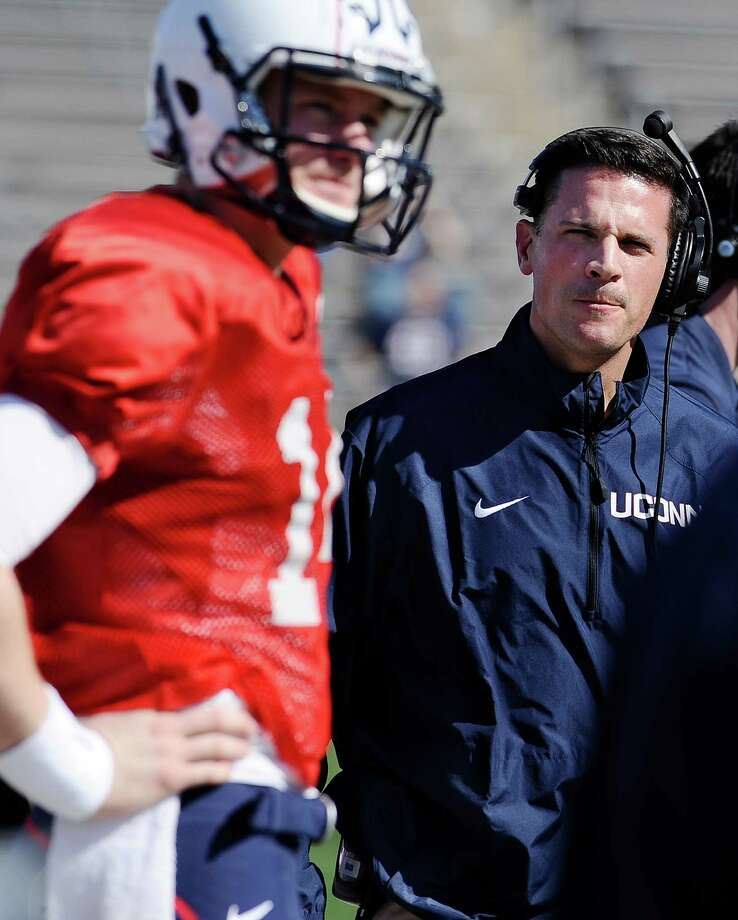 Connecticut head coach Bob Diaco, right, looks toward quarterback Tim Boyle, left, during the first half of a Blue-White spring NCAA college football game at Rentschler Field, Saturday, April 12, 2014, in East Hartford, Conn. (AP Photo/Jessica Hill) Photo: Jessica Hill, Associated Press / Associated Press