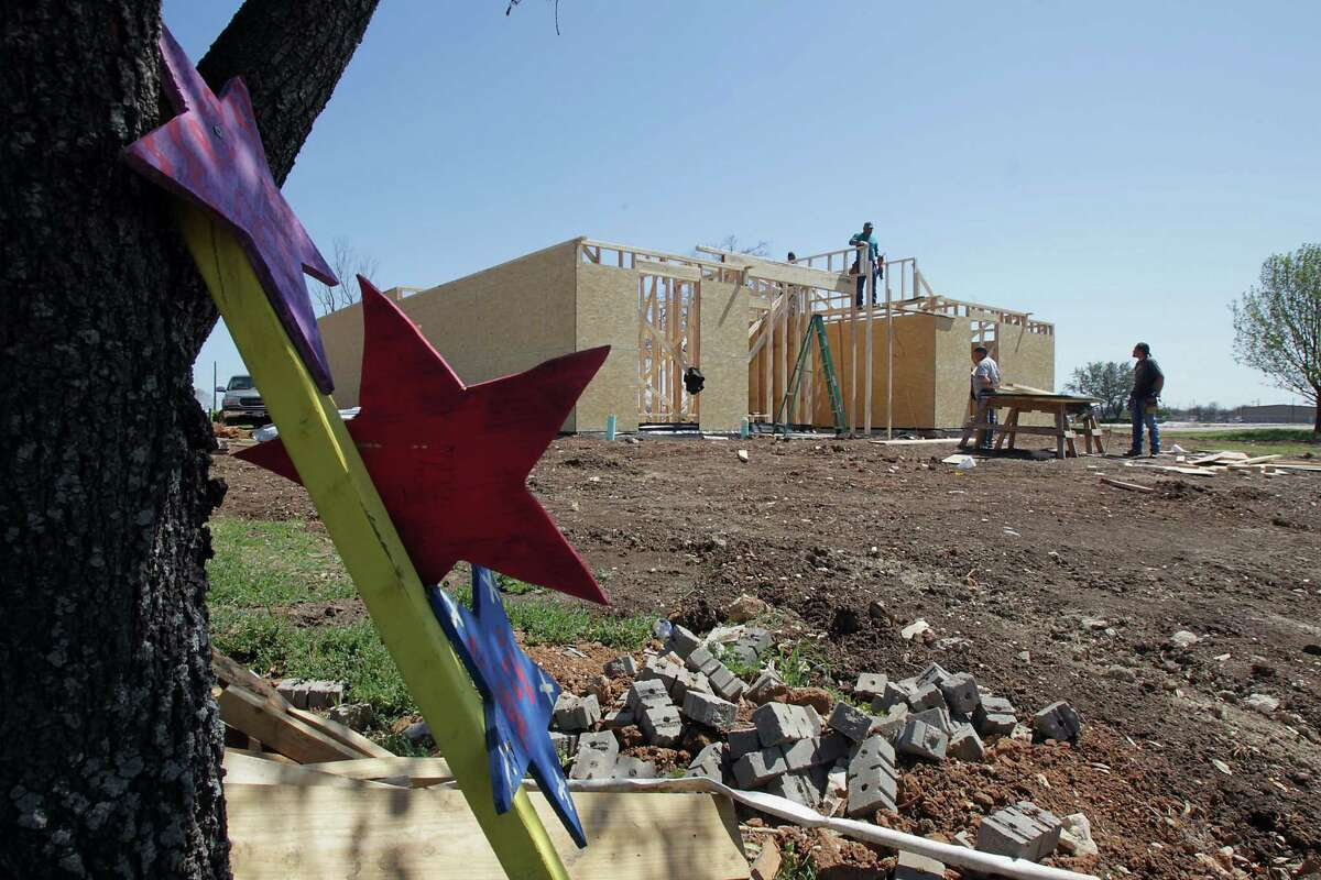 """Stars painted with words like """"hope"""" and """"stay strong"""" are staked in front of homes being rebuilt in the year since the April 17, 2013, fertilizer plant blast."""