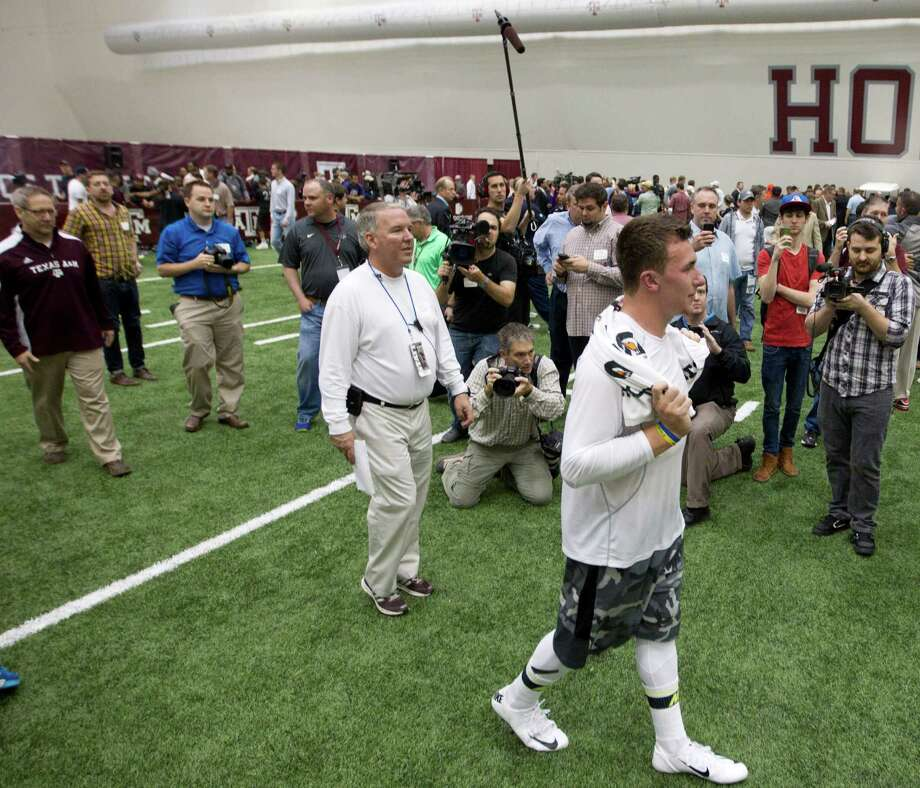 Johnny Manziel embraced the spotlight as Texas A&M's quarterback and drew quite the crowd for his his pro day in College Station on March 27. Photo: Brett Coomer, Houston Chronicle / © 2014 Houston Chronicle