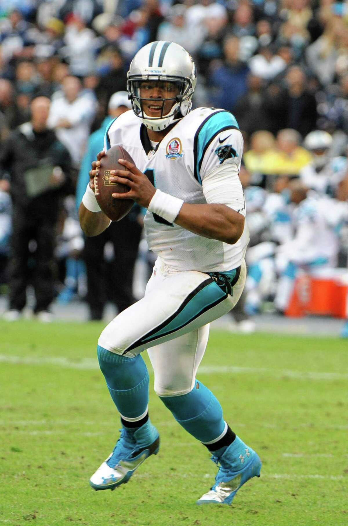 Carolina Panthers quarterback Cam Newton (1) throws during first half of an NFL football game against the San Diego Chargers Sunday, Dec. 16, 2012, in San Diego. (AP Photo/Denis Poroy)