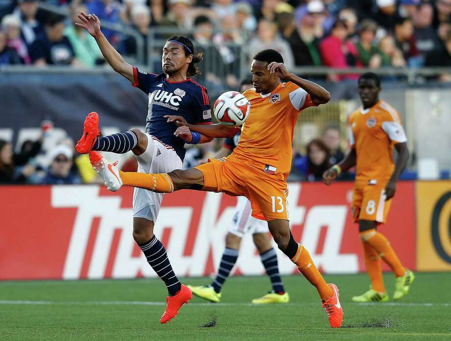 FOXBORO, MA - APRIL 12: Ricardo Clark #13 of the Houston Dynamos battles Daigo Kobayashi #16 of the New England Revolution for control of the ball in the 2nd half at Gillette Stadium on April 12, 2014 in Foxboro, Massachusetts. Photo: Jim Rogash, Getty Images / 2014 Getty Images