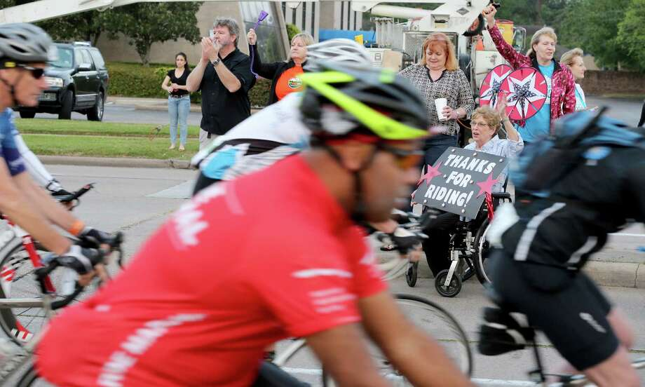 Linda Harris, diagnosed with multiple sclerosis in 2010 at the age of 65, cheers on participants Saturday as they head out from from Houston toward La Grange on the 2014 BP MS 150.  Her husband, Jack, is one of the riders. Photo: Thomas B. Shea, Freelance / © 2014 Thomas B. Shea