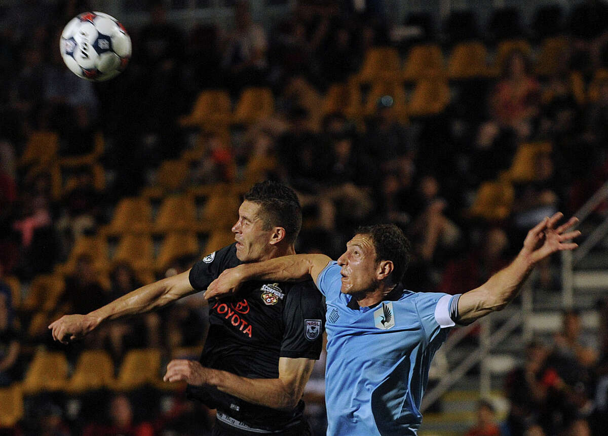 Greg Janicki, left, of the San Antonio Scorpions, and Aaron Pitchkolan (4) of Minnesota United battle for the ball during NASL action at Toyota Field on Saturday, April 12, 2014.