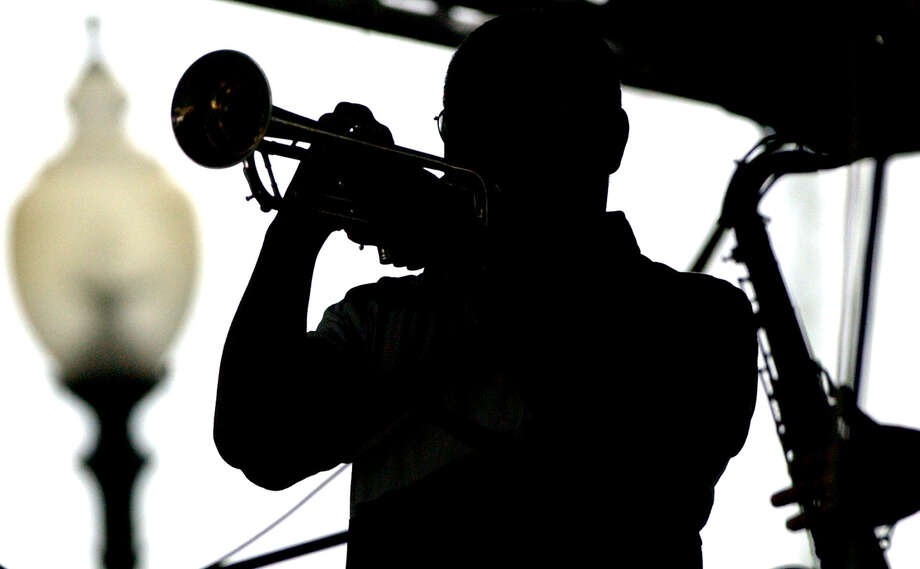 Jazz'SAlive: Annual jazz festival sponsored by the city and the San Antonio Parks Foundation. Sept. 20-22. Travis Park, 300 E. Travis St. Free admission. 210-212-8423 or www.saparks foundation.org.Shown:Cecil Carter of the Regency Jazz band plays the trumpet Sunday at the 20th anniversary of Jazz'SAlive at Travis Park. Rain persisted throughout the day, but hardcore jazz fans watched regardless.  Photo: JOHN DAVENPORT, SAN ANTONIO EXPRESS-NEWS / SAN ANTONIO EXPRESS-NEWS