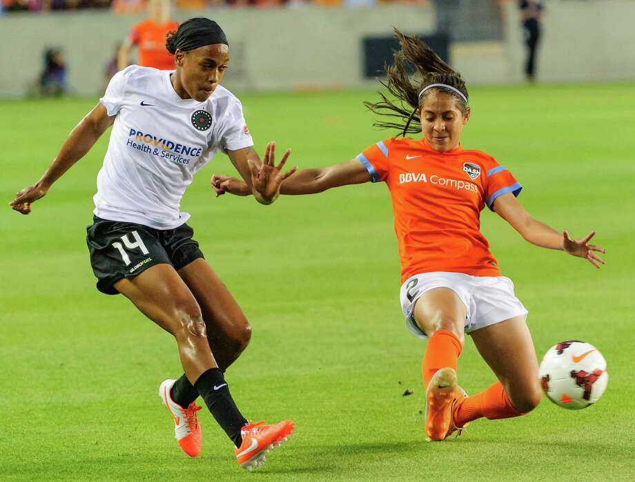 Houston Dash #2 Arianna Romero kicks the ball as Portland Thorns FC #14 Jessica McDonald tries to stop her during game at the BBVA Compass Stadium, 04/12/14. Photo: Kim Christensen / ©Kim Christensen 2013