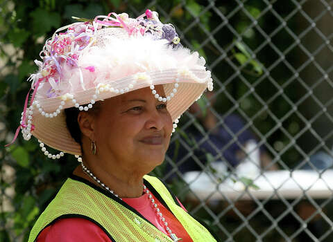 Doris Newton wears one of the hats she has made for Fiesta April 12, 2014 during the 29th Annual Taste of New Orleans at Sunken Garden Theater. Newton makes a hat for every day of Fiesta every year. Photo: For The San Antonio Express-News / For the San Antonio Express-News