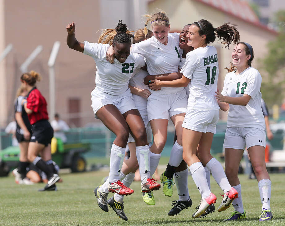 Reagan's Taryn Sherman (left) and her teammates rejoice after her penalty kick defeated rival Churchill in the Region IV-5A girls title match. Photo: Marvin Pfeiffer / San Antonio Express-News / Express-News 2014