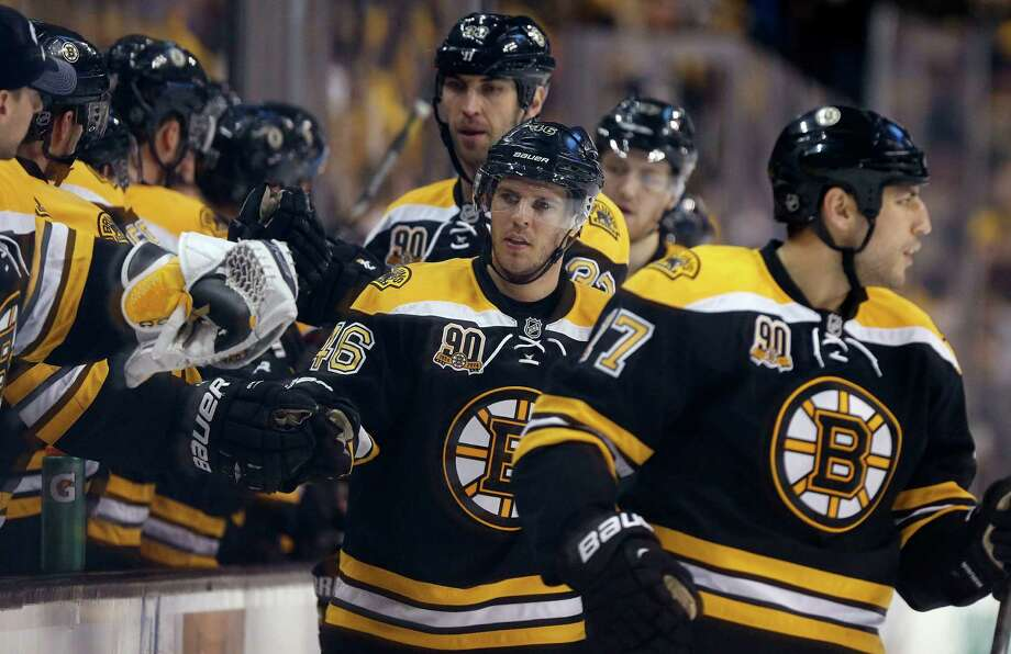 Boston Bruins' David Krejci (46) celebrates his goal with teammates during the first period of an NHL hockey game against the Buffalo Sabres in Boston, Saturday, April 12, 2014. The Bruins won 4-1. (AP Photo/Michael Dwyer) ORG XMIT: MAMD115 Photo: Michael Dwyer / AP