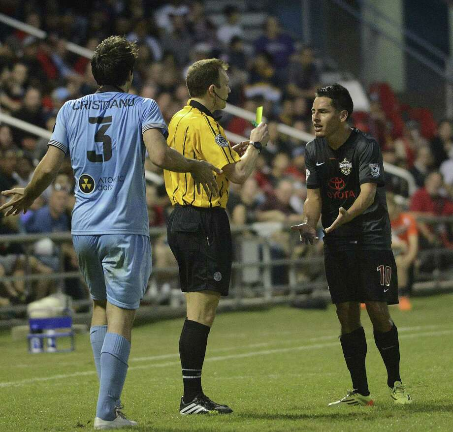 Danny Barrera (right) of the Scorpions argues his case as he is given a yellow card at Toyota Field during Minnesota United's 2-0 victory in the NASL season opener for both teams. Photo: Billy Calzada / San Antonio Express-News / Billy Calzada