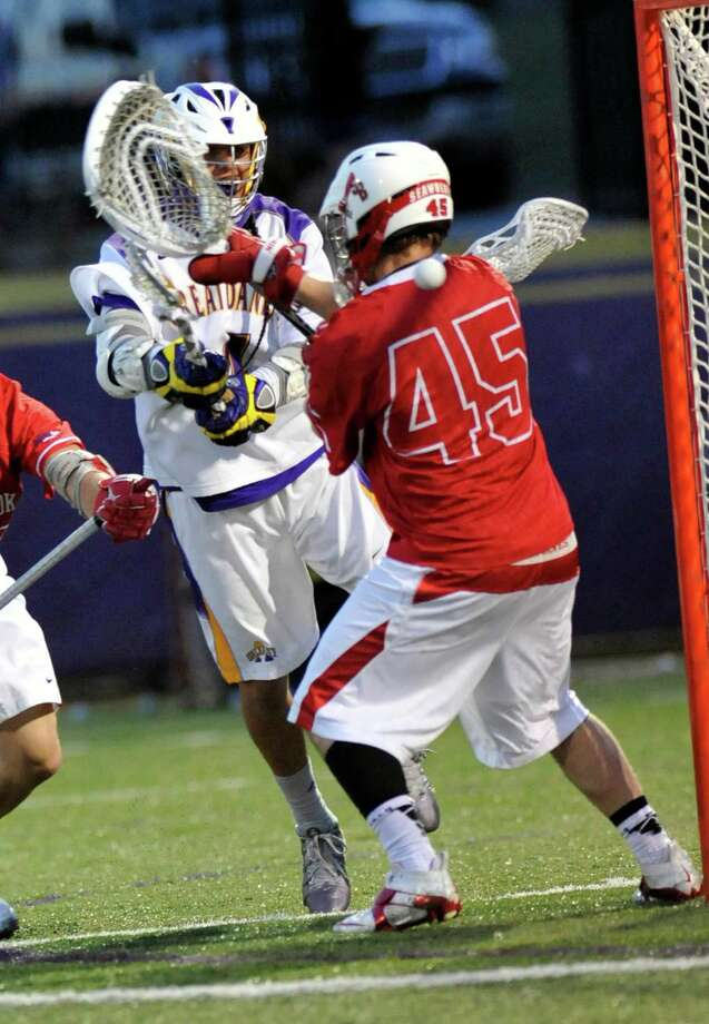 UAlbany's Lyle Thompson (4) scores against Stony Brook goal keeper Hayden Johnstone (45) during the first half of an NCAA college Division I lacrosse game in Albany, N.Y., Saturday, April 12, 2014. (Hans Pennink / Special to the Times Union) ORG XMIT: HP101 Photo: Hans Pennink / Hans Pennink