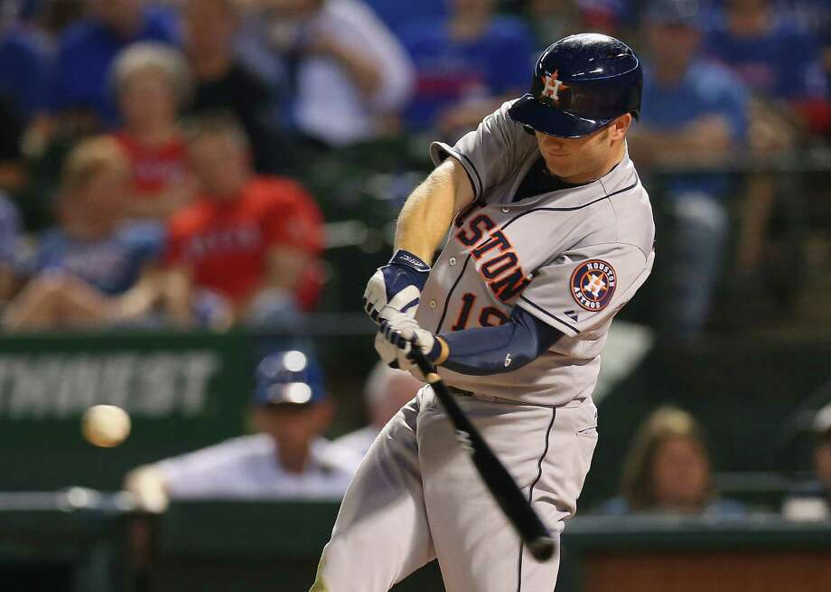 Robbie Grossman of the Astros belts a three-run homer in the fourth inning against the Rangers. Photo: Ronald Martinez / Getty Images / 2014 Getty Images