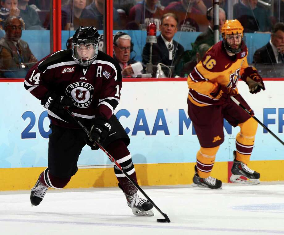 PHILADELPHIA, PA - APRIL 12:  Shayne Gostisbehere #14 of the Union College Dutchmen takes the puck as Nate Condon #25 of the Minnesota Golden Gophers defends during the 2014 NCAA Division I Men's Hockey Championship Game at Wells Fargo Center on April 12, 2014 in Philadelphia, Pennsylvania.  (Photo by Elsa/Getty Images) ORG XMIT: 464911487 Photo: Elsa / 2014 Getty Images