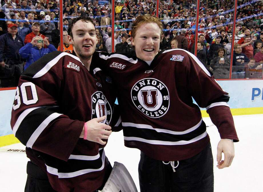 Union's Colin Stevens, left, celebrates a win with teammate Nick Cruice, right, following n NCAA men's college hockey Frozen Four tournament game against Minnesota, Saturday, April 12, 2014, in Philadelphia. Union won 7-4. (AP Photo/Chris Szagola) ORG XMIT: PACS118 Photo: Chris Szagola / FR170982 AP