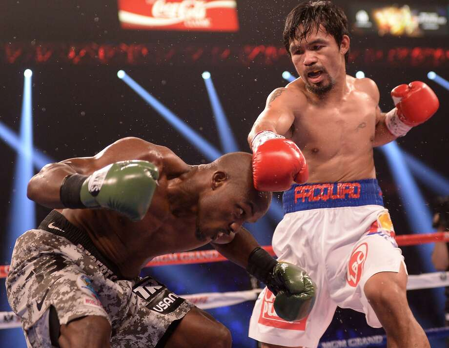 Manny Pacquiao punches previously unbeaten WBO welterweight champ Timothy Bradley. Photo: Joe Klamar, AFP/Getty Images