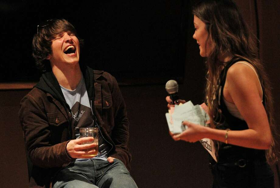"""Google Web developer Rico Rodriguez (left) laughs as he is """"burned"""" by Destini Bryant, who also riffed that the Google buses with Wi-Fi were nicer than her studio, during the """"Roast of a Techie"""" at Playland Bar in San Francisco. Photo: Leah Millis, San Francisco Chronicle"""