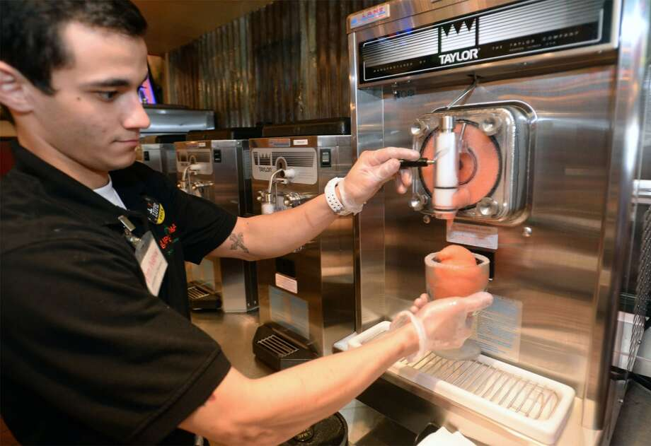 Eric Brower prepares a frozen strawberry margarita at Lupe Tortilla in Beaumont. 2050 I-10 S in Beaumont. Photo taken Wednesday, April 2, 2014 Guiseppe Barranco/@spotnewsshooter