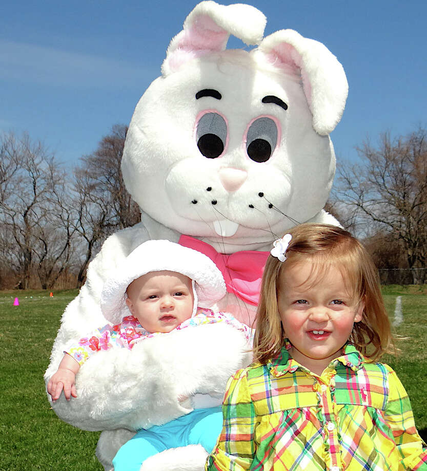 Greta and Collette Siewert, 5 months and 22 months old, with the Easter Bunny at the Parks and Recreation Department on Saturday afternoon at Sullivan Field. Photo: Mike Lauterborn / Fairfield Citizen