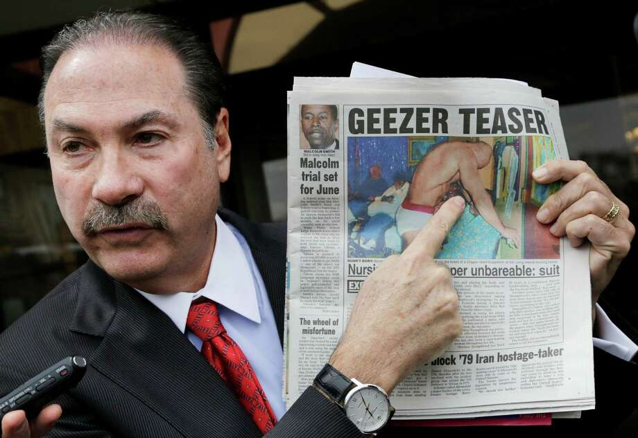 """Attorney Howard Fensterman, representing the East Neck Nursing and Rehabilitation Center, points to a newspaper article about the nursing home during a news conference, Tuesday, April 8, 2014. in West Babylon, N.Y. The nursing home hired a male exotic dancer to perform for its patients, according to a lawsuit filed by facility resident Bernice Youngblood in State Supreme Court in Suffolk County. Fensterman acknowledged the home hired the dancer, but said that Youngblood's attendance was voluntary.The Associated Press adds ... An 85-year-old nursing home patient was the victim of """"disgraceful sexual perversion"""" when a male stripper gyrated in front of her against her will at the suburban New York facility, an attorney for the woman's family said Tuesday.  John Ray, the attorney for Bernice Youngblood and her family, displayed a picture of a man in white briefs dancing in front of the woman at East Neck Nursing and Rehabilitation Center in September 2012.  The photo, which Ray said Youngblood's son found during a visit to his mother, shows the woman putting money into the dancer's waistband.  Ray said Youngblood had been urged to participate and did so against her will. The family has filed suit against the nursing home seeking unspecified damages.  Ray said Youngblood, who herself had worked as a health aide for the elderly, had her dignity taken away when """"nursing home employees subjected her to this disgraceful sexual perversion."""" Photo: Mark Lennihan, AP  / AP"""
