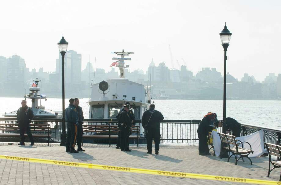 Police at the scene where divers found the bodies of two people, right, in the Hudson River near Sinatra Park after a search by units from New York City and New Jersey began early monring,  Sunday, April 13, 2014 in Hoboken, N.J. Photo: Joe Epstein, AP  / FR170243 AP