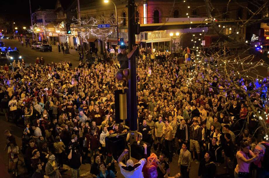 Fans celebrate in the streets in Minneapolis after the University of Minnesota college hockey team defeated North Dakota in a semifinal game at the Frozen Four in Philadelphia, Thursday night, April 10, 2014, Photo: Bridget Bennett, AP  / The Minnesota Daily