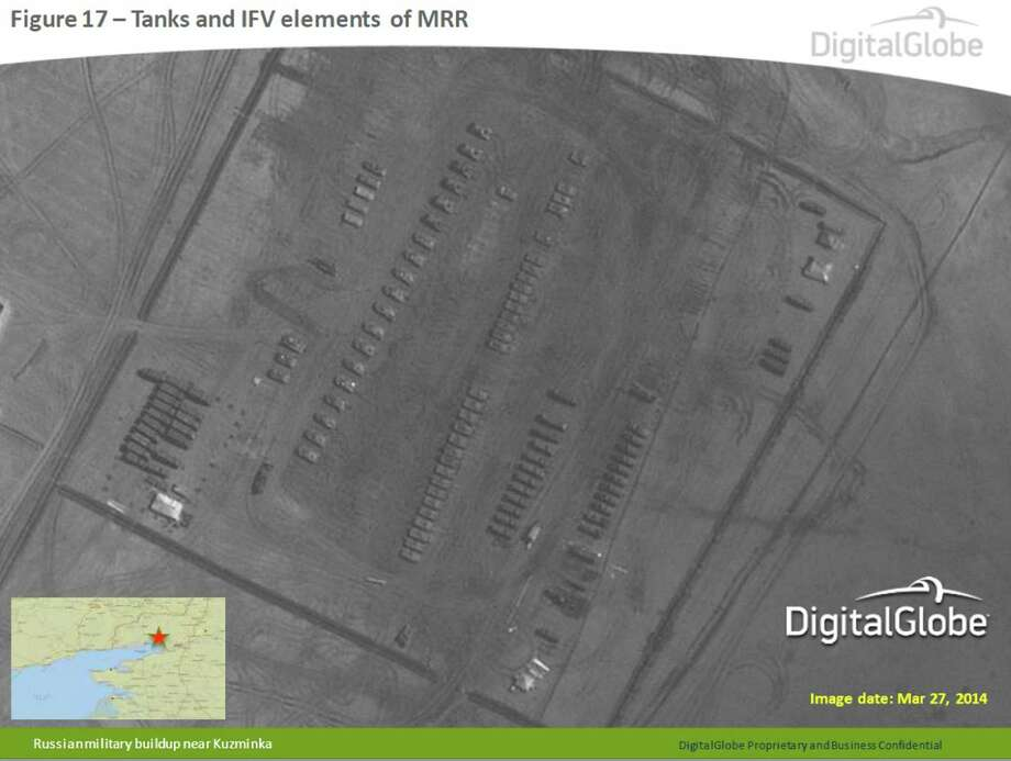 This satellite image made by DigitalGlobe on March 27, 2014, and provided by Supreme Headquarters Allied Powers Europe (SHAPE) on Tuesday, April 9, 2014, shows what are purported to be Russian military tanks and infantry fighting vehicles at a military base near Kuzminka, east of the Sea of Azov in southern Russia. The image is one of several provided to the AP by NATO's headquarters that show dozens of Russian tanks and other armored vehicles, combat jets and helicopter gunships stationed inside Russian territory near to the eastern border with Ukraine. AP cannot independently verify the authenticity or content of this image. (AP Photo/DigitalGlobe via SHAPE) Photo: Uncredited, AP  / AP2014