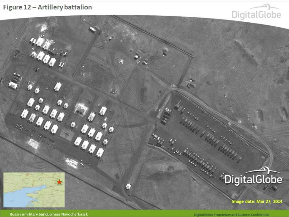 This satellite image made by DigitalGlobe on March 27, 2014, and provided by Supreme Headquarters Allied Powers Europe (SHAPE) on Tuesday, April 9, 2014, shows what is purported to be a Russian artillery battalion at a military base near Novocherkassk, east of the Sea of Azov in southern Russia. The image is one of several provided to the AP by NATO's headquarters that show dozens of Russian tanks and other armored vehicles, combat jets and helicopter gunships stationed inside Russian territory near to the eastern border with Ukraine. AP cannot independently verify the authenticity or content of this image. (AP Photo/DigitalGlobe via SHAPE)  Photo: Uncredited, AP  / AP2014