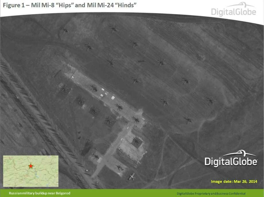 "This satellite image made by DigitalGlobe on March 26, 2014, and provided by Supreme Headquarters Allied Powers Europe (SHAPE) on Tuesday, April 9, 2014, shows what are purported to be Russian Mil Mi-8 ""Hips"" and Mil Mi-24 ""Hinds"" aircraft in Belgorod, southern Russia, about 50 km north of the Russian border with eastern Ukraine. The image is one of several provided to the AP by NATO's headquarters that show dozens of Russian tanks and other armored vehicles, combat jets and helicopter gunships stationed inside Russian territory near to the eastern border with Ukraine. AP cannot independently verify the authenticity or content of this image. (AP Photo/DigitalGlobe via SHAPE)  Photo: Uncredited, AP  / AP2014"