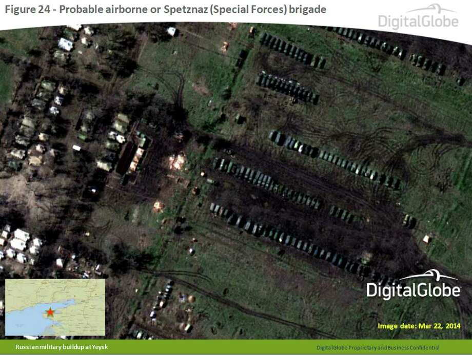 This satellite image made by DigitalGlobe on March 22, 2014, and provided by Supreme Headquarters Allied Powers Europe (SHAPE) on Tuesday, April 9, 2014, shows what is purported to be a Russian military airborne or Spetznaz (Special Forces) brigade at Yeysk, near the Sea of Azov in southern Russia. The image is one of several provided to the AP by NATO's headquarters that show dozens of Russian tanks and other armored vehicles, combat jets and helicopter gunships stationed inside Russian territory near to the eastern border with Ukraine. AP cannot independently verify the authenticity or content of this image. (AP Photo/DigitalGlobe via SHAPE)  Photo: Uncredited, AP  / AP2014