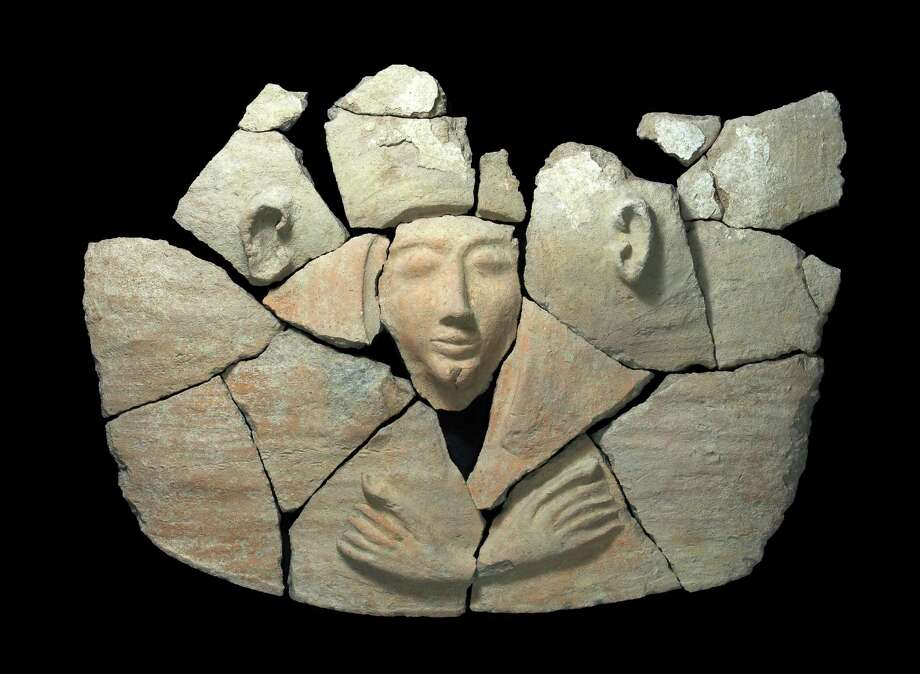 This undated photo released by Israel,s Antiquities Authority shows a sarcophagus found at Tel Shadud, an archaeological mound in the Jezreel Valley. Israeli archaeologists have unearthed a rare sarcophagus featuring a slender face and a scarab ring inscribed with the name of an Egyptian pharaoh, Israel's Antiquities Authority said Wednesday April 9, 2014. Photo: Uncredited, AP  / AP2014