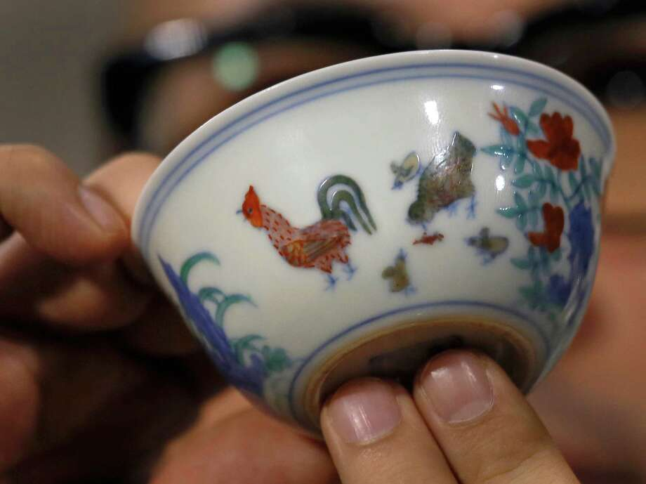 "The Meiyintang ""Chicken Cup"" from the Chinese Ming Dynasty (1368-1644) is displayed during a press conference in Hong Kong, Tuesday, April 8, 2014. Sotheby's said Shanghai collector Liu Yiqian won the bidding for the ""Chicken Cup,"" which is decorated with a rooster, hen and their chicks. Including the auction house's commission, the price for the small cup comes to HK$281.2 million (US$36.1 million), which Sotheby's said is a world record price for Chinese porcelain. Photo: Vincent Yu, AP  / AP2014"