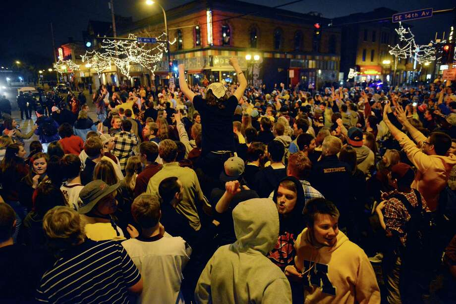 A rowdy crowd is seen following the Gopher men's hockey loss on  Saturday night April 12, 2014 after the Gophers' loss in the NCAA final. Violence erupted despite increased police presence following the raucous celebration. Photo: Amanda Snyder, AP  / The Minnesota Daily