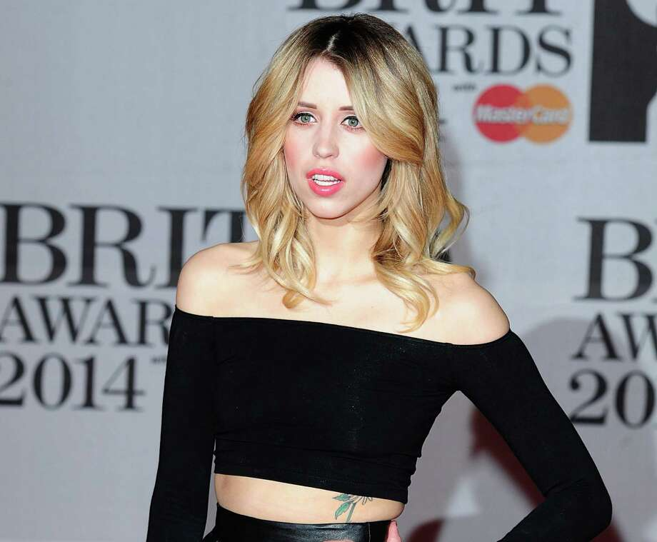 "Peaches Geldof, the model and television presenter who was concert organizer Bob Geldof's daughter, has died at age 25. Bob Geldof said in a statement Monday, April 7, 2014: ""Peaches has died. We are beyond pain."" (AP Photo/PA, Ian West, File) In this Feb. 19, 2014 file photo Peaches Geldof, daughter of Bob Geldof is seen at the Brit Awards 2014, in London. Photo: Ian West, AP  / AP2014"
