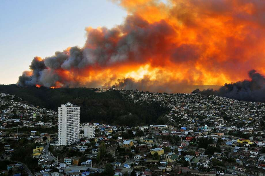 A massive firerages in Valparaiso, Chile. Twelve people were killed and more than 2,000 houses destroyed in the   conflagration. Photo: Alberto Miranda, AFP/Getty Images