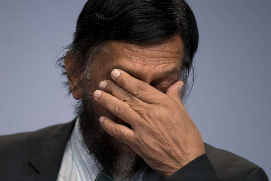 IPCC Working Group III Chairman Rajendra Pachauri gestures as he attends a news conference to present Working Group III's summary for policymakers at The Intergovernmental Panel on Climate Change (IPCC) in Berlin April 13, 2014. REUTERS/Steffi Loos  (GERMANY - Tags: POLITICS ENVIRONMENT) Photo: Stefanie Loos, Reuters