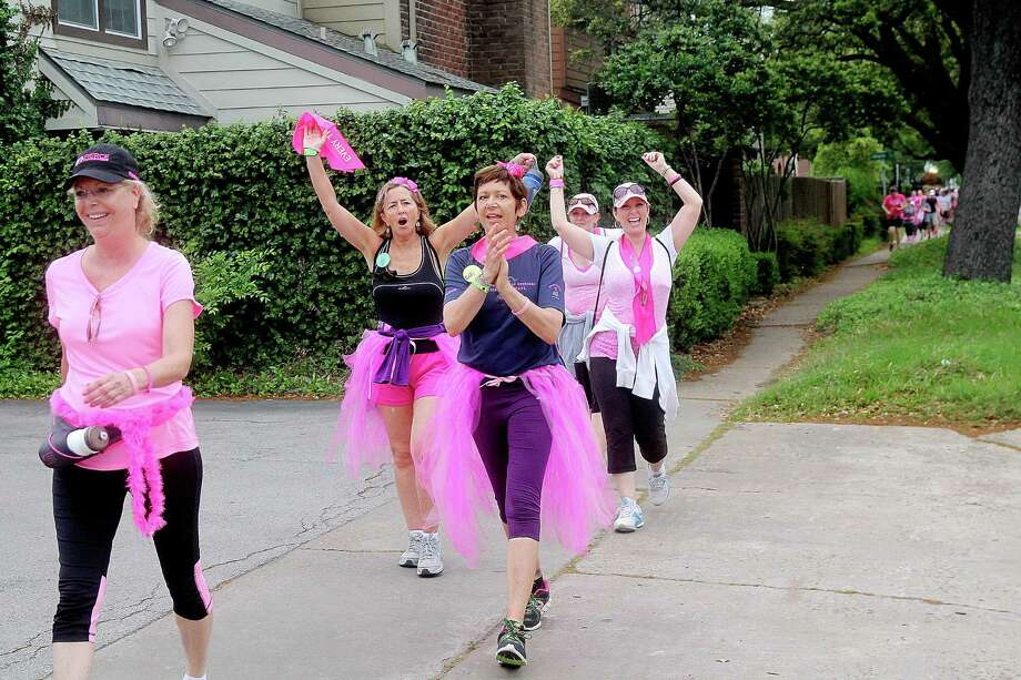 Walkers along Montrose Blvd during the 2nd leg of the Avon Walks for Breast Cancer Houston. More than 1400 participants registered for this year's event. Photo by Pin Lim. Photo: Pin Lim, For The Chronicle / Copyright Pin Lim.
