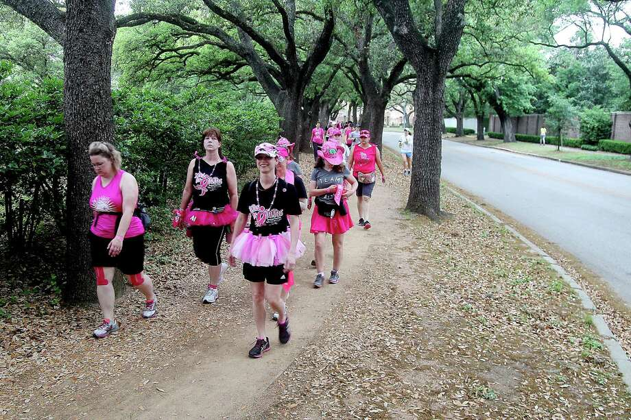 Walkers along Sunset Blvd during the 2nd leg of the Avon Walks for Breast Cancer Houston at the Avon Walk Wellness Village, Rice University. Photo by Pin Lim. Photo: Pin Lim, For The Chronicle / Copyright Pin Lim.