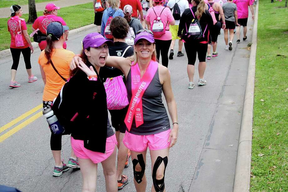 Walkers in good spirits during the 2nd leg of the Avon Walks for Breast Cancer Houston at the Avon Walk Wellness Village, Rice University. Photo by Pin Lim. Photo: Pin Lim, For The Chronicle / Copyright Pin Lim.