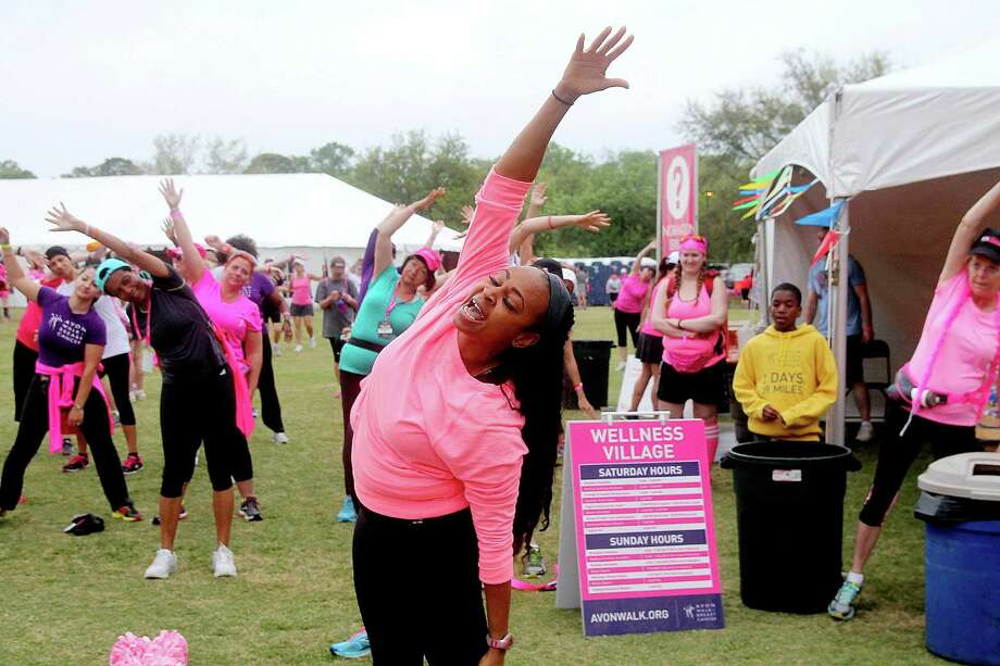 Katherine Devoe warming up the participants before the 2nd leg of the Avon Walks for Breast Cancer Houston at the Avon Walk Wellness Village, Rice University. More than 1400 participants registered this year's event. Photo by Pin Lim. Photo: Pin Lim, For The Chronicle / Copyright Pin Lim.