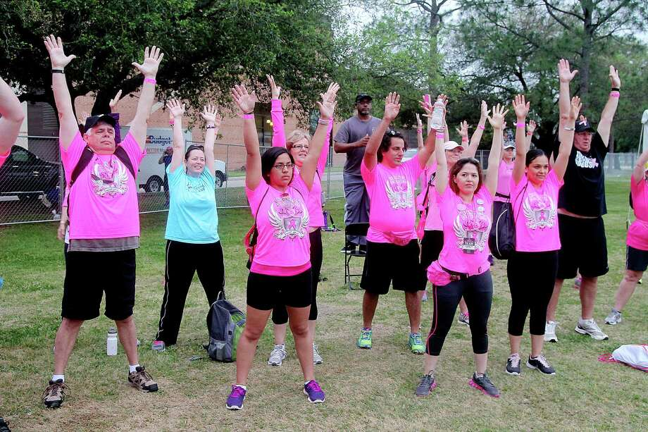 Walkers warming up before the 2nd leg of the Avon Walks for Breast Cancer Houston at the Avon Walk Wellness Village, Rice University. More than 1400 participants registered this year's event. Photo by Pin Lim. Photo: Pin Lim, For The Chronicle / Copyright Pin Lim.