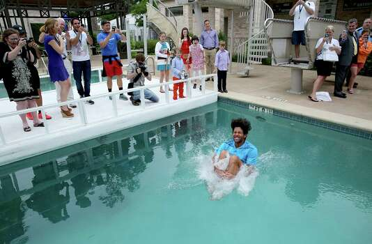 Fernando Verdasco (ESP) jumps in the River Oaks Country Club Pool after defeating Nicolas Almagro (ESP) ) 6-3, 76 in the singles finals on April 13, 2014 at the U.S. Men's Clay Court Championship at River Oaks in Houston, TX. . Photo: Thomas B. Shea, For The Chronicle / © 2014 Thomas B. Shea