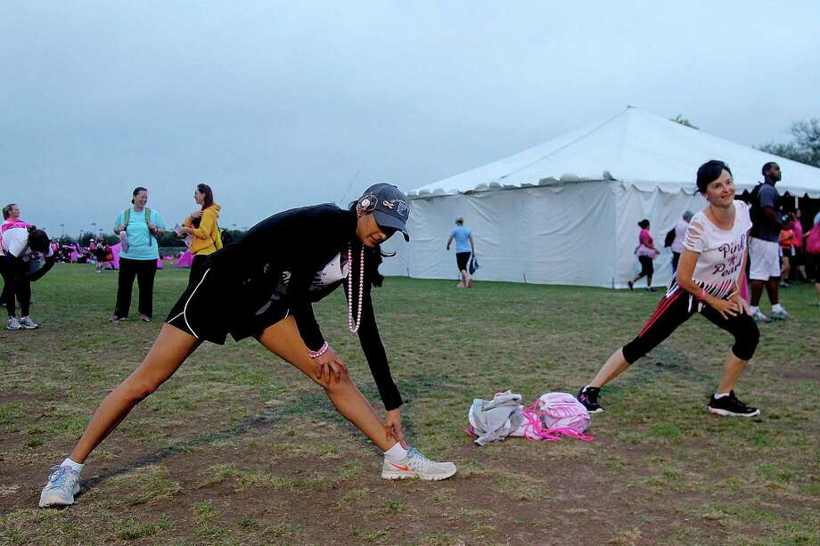 Sarika Patel (77056) and Denise Cardozo (77584) warming up before the 2nd leg of the Avon Walks for Breast Cancer Houston at the Avon Walk Wellness Village, Rice University. Photo by Pin Lim. Photo: Pin Lim, For The Chronicle / Copyright Pin Lim.