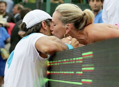 Fernando Verdasco (ESP) is congratulated and kisses his host family member Courtney Sarofim after defeating Nicolas Almagro (ESP) ) 6-3, 76 in the singles finals on April 13, 2014 at the U.S. Men's Clay Court Championship at River Oaks in Houston, TX. . Photo: Thomas B. Shea, For The Chronicle / © 2014 Thomas B. Shea