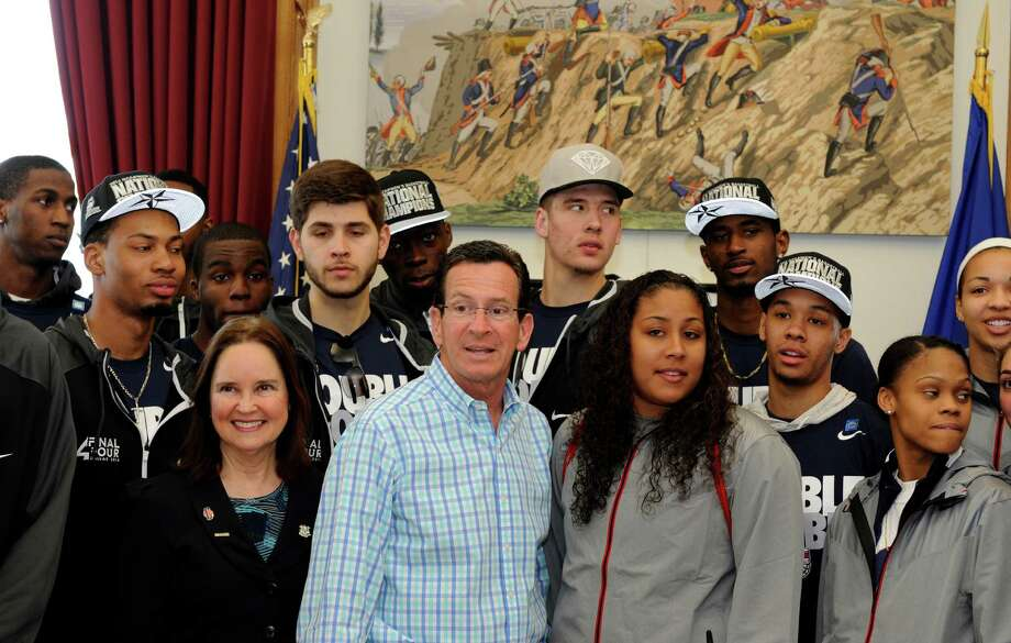 Members of Connecticut's men's and women's basketball teams gather with Connecticut Gov. Dannel P. Malloy in his office, Sunday, April 13, 2014, in Hartford, Conn. Both teams won the NCAA championship. Photo: Fred Beckham, AP / Associated Press