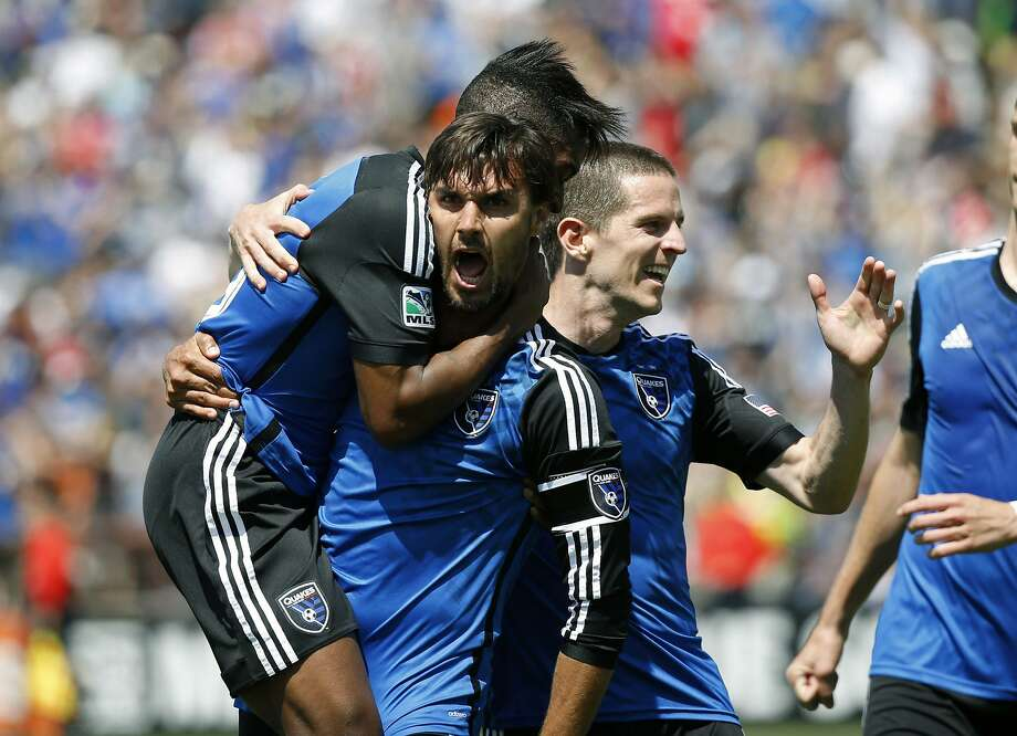An ecstatic San Jose forward Chris Wondolowski is pounced upon by midfielder Yannick Djalo after scoring the tying goal in Santa Clara. Photo: Robert Stanton, Reuters